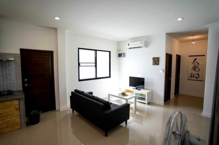 For sale Newly built house, one year old, C shaped living area with enclosed outdoor space.
